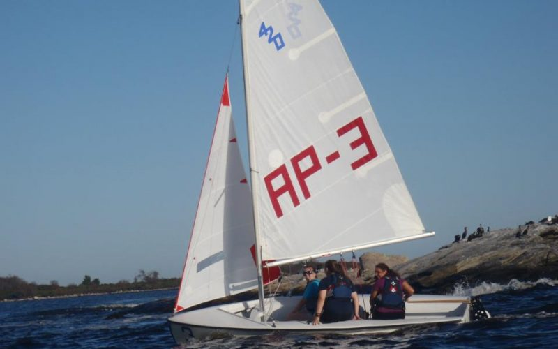 A photo of a sailing club vessel going past Avery Point