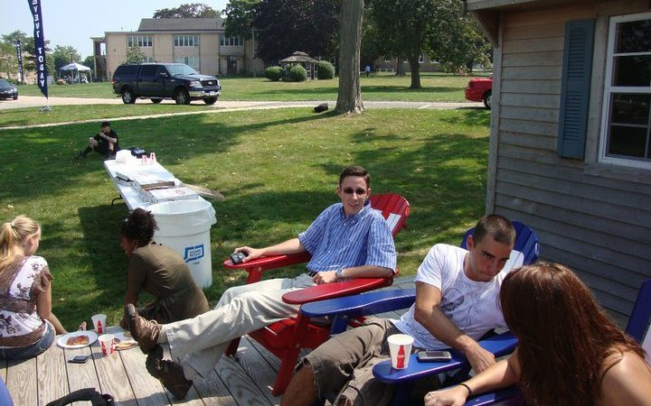 Photo of students relaxing at the Avery Point boat shed