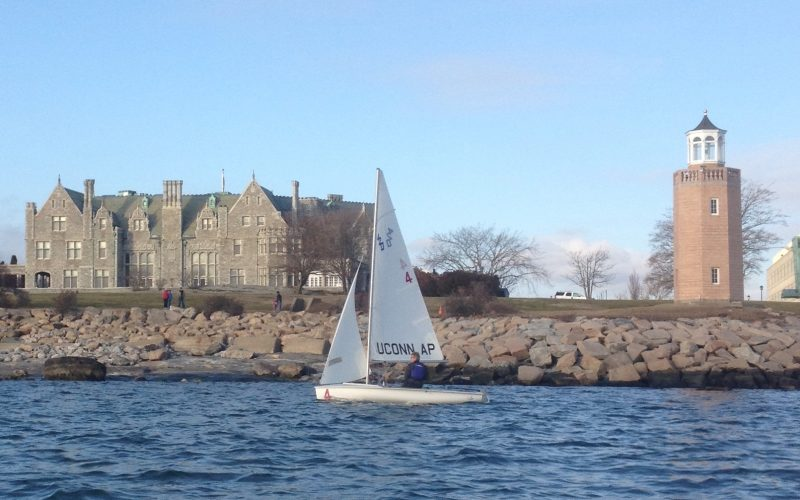 A photo of a sailboat sailing by the campus