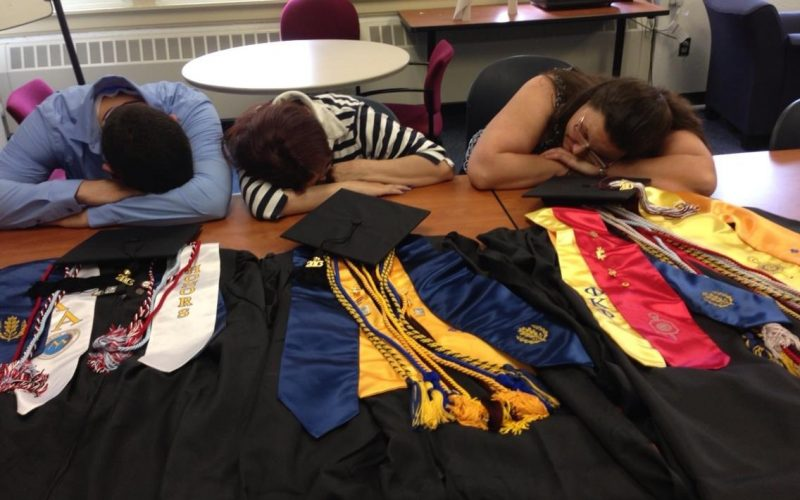 Photo of three tired Avery Point Graduates before commencement ceremony